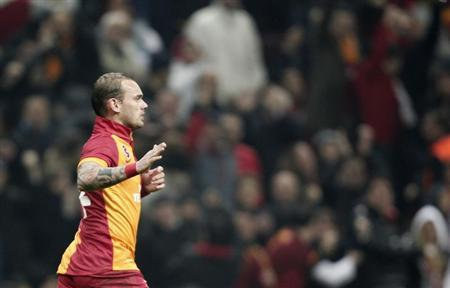 Galatasaray's Sneijder celebrates after scoring a goal against Real Madrid during their Champions League quarter-final second leg soccer match in Istanbul