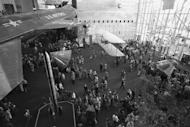 The Milestones of Flight gallery draws a large crowd of visitors in the newly opened National Air and Space Museum, as seen in this photograph taken December 28, 1976.
