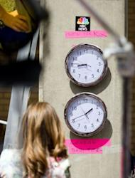 "Clocks showing New York and ""London Baby Time"" are hung on a wall in the media pen outside the Lindo Wing of Saint Mary's Hospital in London, on July 15, 2013"