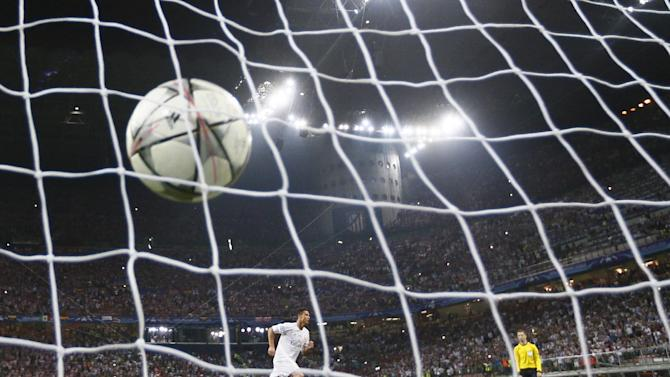 Real Madrid's Cristiano Ronaldo celebrates after scoring the winning penalty in the shootout