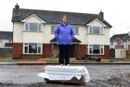 Rhoda Brogan poses for a photograph on the Glenall housing estate in the village of Borris-in-Ossory, County Laois, Ireland February 13, 2013. REUTERS/Cathal McNaughton