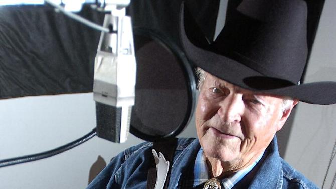 "In a Dec. 17, 2007 photo Claude King works on his latest album he is recording at the Red River Studio in Shreveport, La.   Country singer-songwriter Claude King, an original member of the Louisiana Hayride who was best known for the 1962 hit ""Wolverton Mountain,"" has died. He was 90.  (AP Photo/Douglas Collier/The (Shreveport) Times)  (AP Photo/The Shreveport Times,Douglas Collier ) MAGS OUT; MANDATORY CREDIT SHREVEPORTTIMES.COM;  NO SALES"
