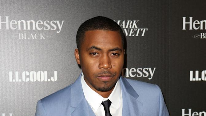 "FILE - In this Feb. 9, 2013 file photo released by Hennessy, hip hop artist Nas attends Hennessy Black: A Dinner with LL Cool J and Mark Burnett Celebrating Music's Biggest Night Out in Los Angeles. Harvard University announced Tuesday, July 16, that the 39-year-old rapper is being honored with the Nasir Jones Hip-Hop Fellowship at its W. E. B. Du Bois Institute. It is a joint venture with Harvard's Hip-Hop Archive. The fellowship will assist students who excel in the arts ""in connection with hip-hop."" Nas is one of hip-hop's most celebrated lyricists, best known for his reflective rhymes and deep storytelling. (AP Photo/Hennessy, Casey Rodgers, File)"