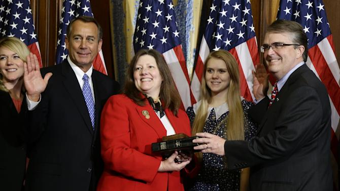 House Speaker John Boehner of Ohio performs a mock swearing in for Rep. John Culberson, R-Texas, Thursday, Jan. 3, 2013, on Capitol Hill in Washington as the 113th Congress began. (AP Photo/Charles Dharapak)