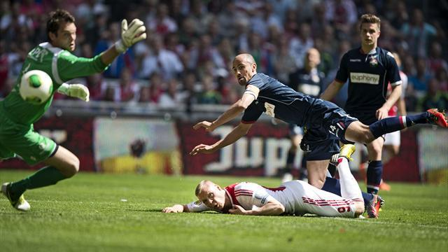 European Football - Ajax thrash Tilburg 5-0 to complete title hat-trick