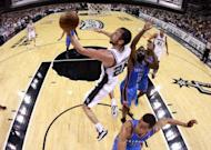 San Antonio Spurs' Manu Ginobili shoots during game one of the NBA Western Conference Finals on May 27. The Spurs turned it on in the fourth quarter to beat Oklahoma 101-98