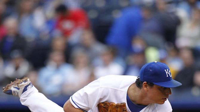 Royals hold on to beat hot-hitting Indians 9-5
