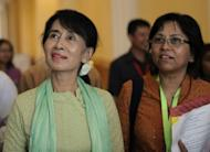 Myanmar opposition leader Aung San Suu Kyi (L), seen here during a break after a lower house parliament session in Naypyidaw, on July 9. Suu Kyi made her historic parliamentary debut, marking a new phase in her near quarter century struggle to bring democracy to her army-dominated homeland
