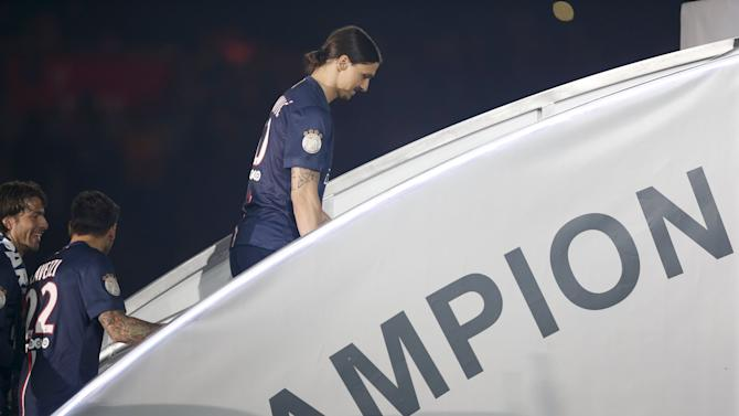Paris St Germain's Zlatan Ibrahimovic walks on podium after their final French first division Ligue soccer match of the season against Reims at the Parc des Princes stadium in Paris