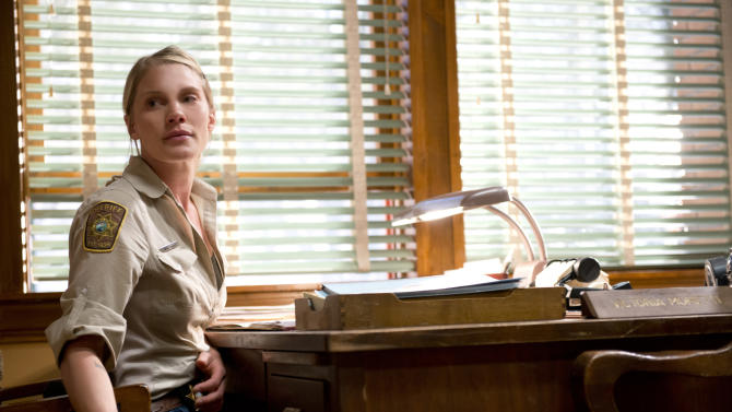 "This undated image released by A&E shows actress Katee Sackhoff portraying Victoria ""Vic"" Moretti in a scene from A&E's new original drama series, ""Longmire.""  Sackhoff, 32, has had success playing women who aren't shrinking violets. She starred as Kara ""Starbuck"" Thrace on ""Battlestar Galactica,"" which made her a fan boy sex symbol. Now she's holding her own as Deputy Sheriff Victoria ""Vic"" Moretti on ""Longmire,"" based on the best-selling novels by Craig Johnson. (AP Photo/A&E, Ursula Coyote)"
