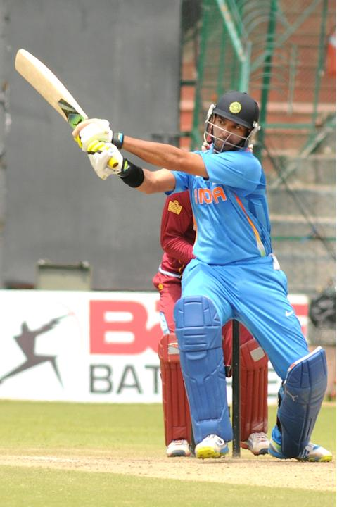 Indian A team sipper Yuvraj Singh in action against West Indies A team, during  India A team v/s West Indies A team unofficial T-20 cricket match at Chinnaswamy Stadium, in Bangalore on Saturday 21st