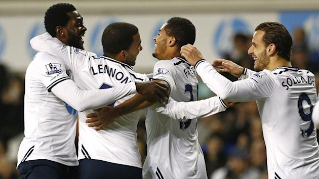 Tottenham Hotspur's Aaron Lennon (2nd L) celebrates his goal against Stoke City with Zeki Fryers (2nd R), Roberto Soldado (R) and Emmanuel Adebayor (L) (Reuters)