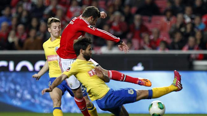 Benfica's Miralem Sulejmani, centre, from Serbia, is faulted inside Arouca's penalty area by Arouca's Nuno Coelho, right, during a Portuguese league soccer match between Benfica and Arouca at Benfica's Luz stadium in Lisbon, Friday, Dec. 6, 2013. The match ended in a 2-2 draw