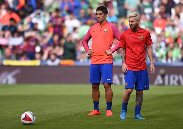 Barcelona's Luis Suarez and Lionel Messi warm up before the match