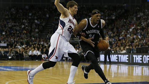Paul Pierce (R) of the Brooklyn Nets dribbles past Kyle Korver of the Atlanta Hawks during their NBA basketball game at the O2 in London (Reuters)