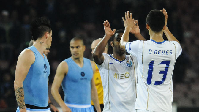 Porto's Reyes, right, and teammate Fernando celebrate at the end of an Europa League, round of 16 return-leg soccer match against Napoli at the Naples San Paolo stadium, Italy, Thursday, March 20, 2014