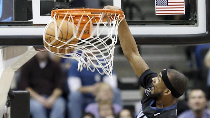 Minnesota Timberwolves' Corey Brewer dunks in the second half of an NBA basketball game against the Denver Nuggets, Wednesday, Nov. 27, 2013, in Minneapolis. The Nuggets won 117-110