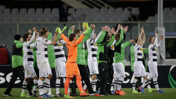 Borussia Monchengladbach players celebrate after the match