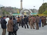 This file photo shows Pyongyang residents waiting outside a fun-fair in the centre of the N.Korean capital. N.Korea's leader Kim Jong-Un has scolded staff for neglecting their duties and failing to serve the people during a tour of an amusement park in a Pyongyang suburb, state media reported on Wednesday