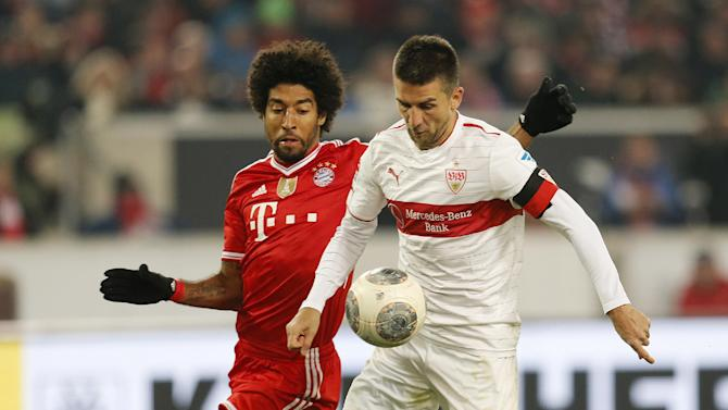 Stuttgart's Vedad Ibisevic of Bosnia, right, and Bayern's Dante of Brazil challenge for the ball during a German first soccer division Bundesliga match between VfB Stuttgart and FC Bayern Munich in Stuttgart, Germany, Wednesday, Jan. 29, 2014