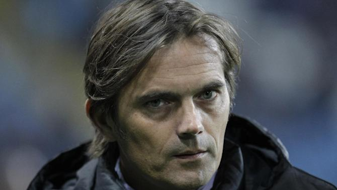 Netherlands PSV's coach Phillip Cocu waits for the start of the Europa League Group B soccer match between FC Chornomorets and  PSV Eindhoven at the Chornomorets  stadium in Odessa , Ukraine, Thursday, Oct. 3, 2013