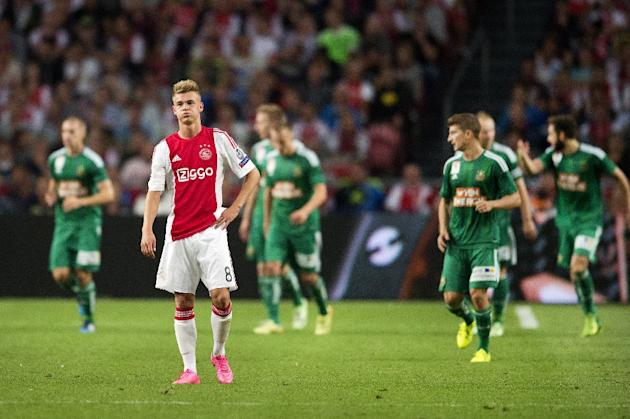 Ajax's Dutch midfielder Daley Sinkgraven (2-L) reacts after losing to Rapid Wien on August 4, 2015 at the Arena Stadium in Amsterdam