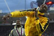 Jamaica's gold medalist Usain Bolt celebrates after the podium ceremony of the men's 100m at the athletics event of the London 2012 Olympic Games on August 6, 2012 in London