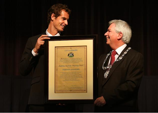 British tennis player Andy Murray, left, receives the Freedom of Stirling presented to him by Stirling Council Provost Mike Robbins during a special council meeting at his old school Dunblane High, in