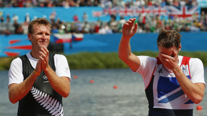 Gold medallist Mahe Drysdale of New Zealand applauds as bronze medallist Alan Campbell of Britain reacts during a ceremony after the Men's Single Sculls Final event during the London 2012 Olympic Games at Eton Dorney