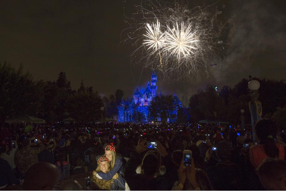 "People watch the new ""Disneyland Forever"" fireworks show during Disneyland's Diamond Celebration in Anaheim, California"