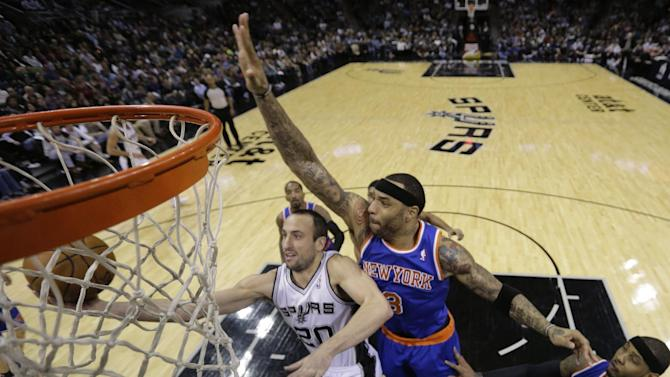 San Antonio Spurs' Manu Ginobili (20), of Argentina, is pressured by New York Knicks' Kenyon Martin (3) and Carmelo Anthony, right, as he tries to score during the second half on an NBA basketball game, Thursday, Jan. 2, 2014, in San Antonio.  New York won 105-101