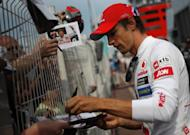 "Jenson Button, pictured signing autographs in Monaco two weeks ago, says he feels ""extremely proud"" returning the Montreal track, rating his victory there last year as his greatest ever win"