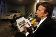 Former Brazilian Formula One driver Emerson Fittipaldi holds a picture of Ayrton Senna during an interview with Reuters in Sao Paulo April 10, 2014. Formula One is remembering Brazilian Ayrton Senna and Austrian Roland Ratzenberger on the 20th anniversary of their deaths in 1994 at the San Marino Grand Prix at Italy's Imola circuit. Picture taken April 10, 2014. REUTERS/Paulo Whitaker (BRAZIL - Tags: SPORT MOTORSPORT F1)