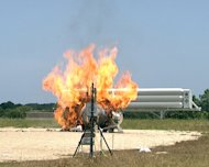 NASA's Morpheus lander prototype in flames during a failed free flight test at the Kennedy Space Center in Cape Canaveral, Fla., on Aug. 9, 2012.