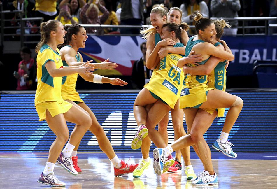 Members of the Australian team celebrate after winning their Netball World Cup final game against New Zealand in Sydney