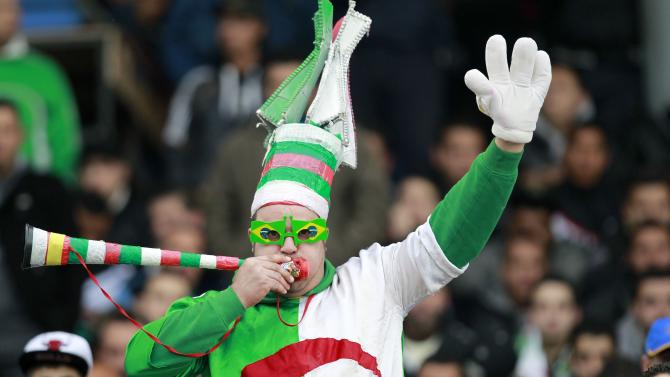 An Algerian fans cheer in the stands during their international friendly soccer match against Slovenia in Algiers