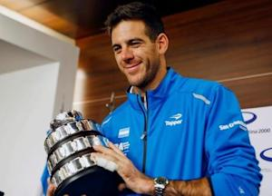Juan Martin del Potro of Argentina's Davis Cup tennis team, holds a trophy after the team's arrival in Buenos Aires