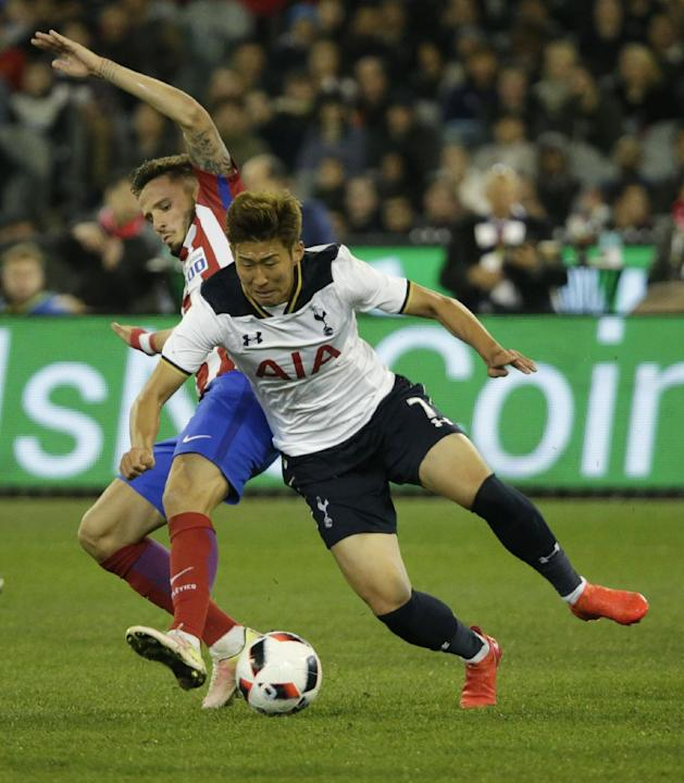 Tottenham's Heung Min Son in action with Atletico Madrid's Saul Niguez