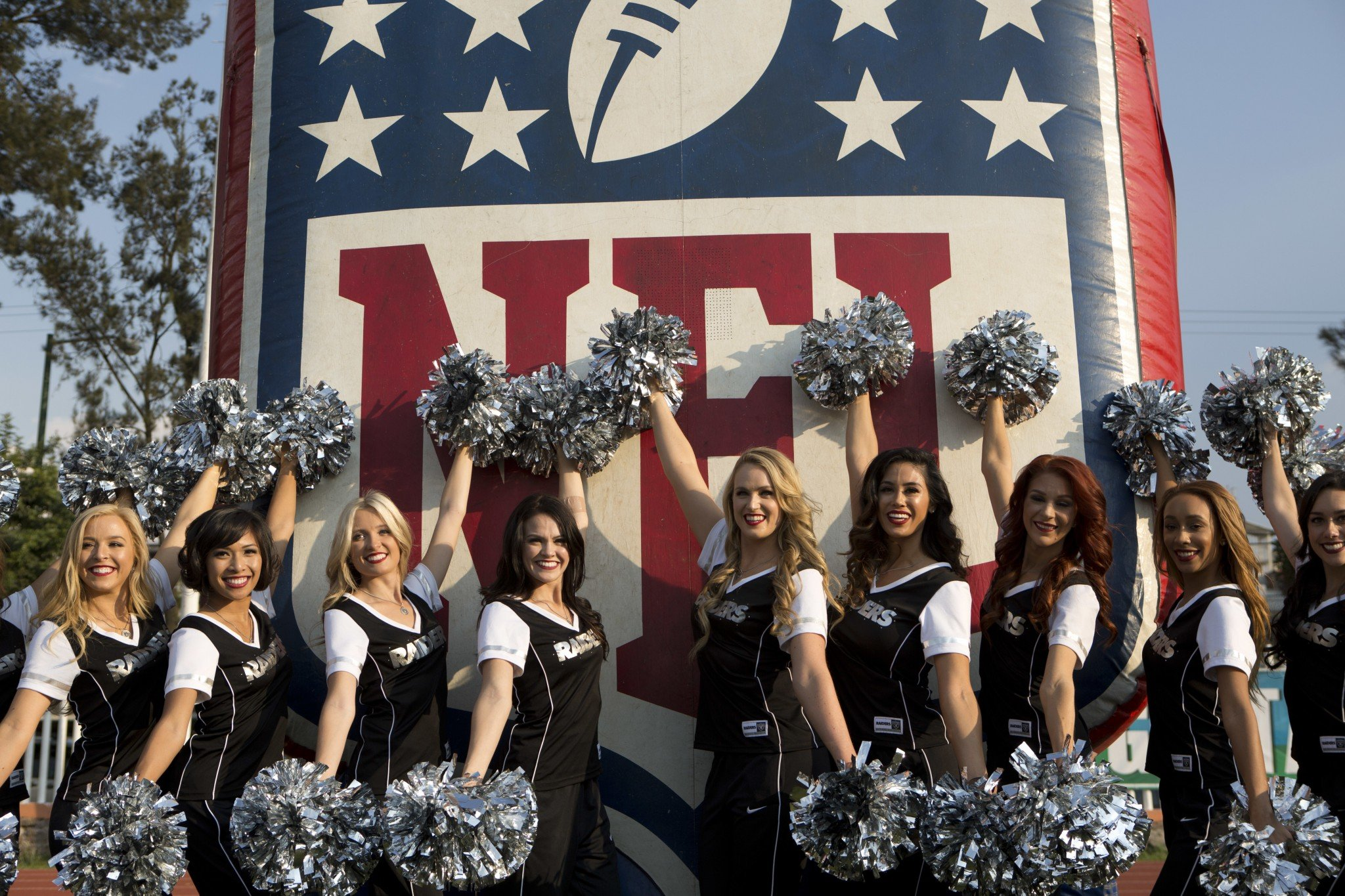 The Oakland Raiders' cheerleaders are adjusting as best they can to the high altitude of Mexico City. (AP)