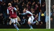 Aston Villa's striker Andreas Weimann (R) celebrates after scoring during their English Premier League football match against Manchester United at Villa Park in Birmingham. Manchester United won 3-2