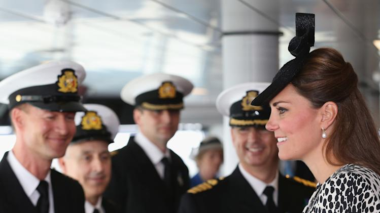 Britain's Duchess of Cambridge speaks to the crew during an on board tour during the Princess Cruises ship naming ceremony to officially name the new Royal Princess cruise liner at a gala ceremony, in Southampton, England, Thursday June 13, 2013. It is expected to be her final planned solo event before the birth. (AP Photo/Chris Jackson, Pool)