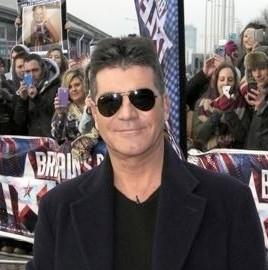 Simon Cowell Defends 'Britain's Got Talent' Policy On Twitter; Show Drops In 3rd Week