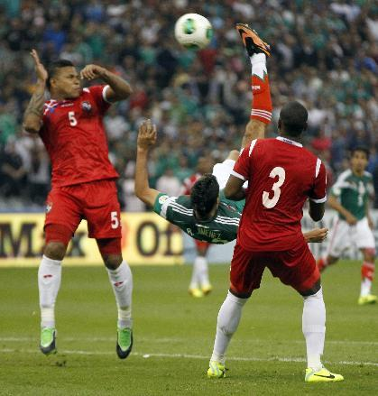 Mexico's Raul Jimenez, center, scores with an overhead kick against Panama during a 2014 World Cup qualifying match, in Mexico City, Friday, Oct. 11, 2013
