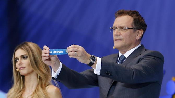 FIFA Secretary General Jerome Valcke shows the ticket of Ivory Coast during the draw ceremony for the 2014 soccer World Cup in Costa do Sauipe near Salvador, Brazil, Friday, Dec. 6, 2013