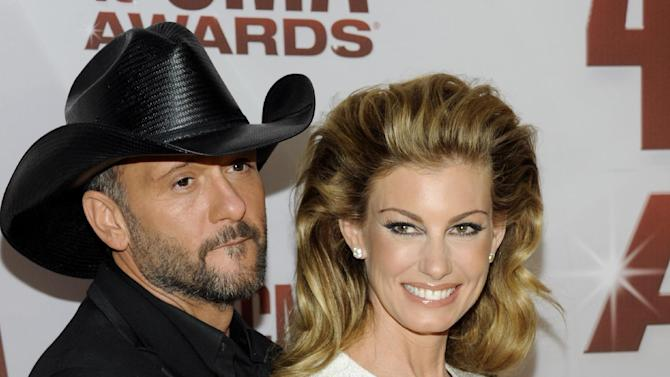 """FILE - This Nov. 9, 2011 file photo shows country singers Tim McGraw, left, and his wife Faith Hill at the 45th Annual CMA Awards in Nashville. will be doing a 10-weekend run of shows at The Venetian starting Dec. 7 through next April. The couple planned to announce the news Tuesday, Aug. 7, 2012, during a news conference at the hotel. The show is called """"Soul2Soul,"""" named after their hugely successful co-headlining tours in 2000 and 2006. The Vegas shows will mark the first time in six years that McGraw and Hill have performed together in the United States.  Pre-sale tickets go on sale Wednesday and open to the general public on Monday, Aug. 13. (AP Photo/Evan Agostini, file)"""