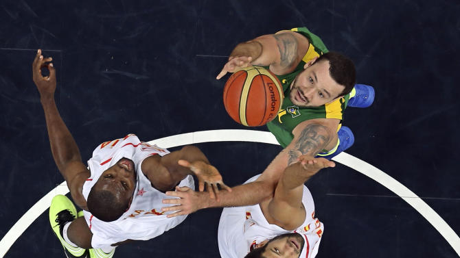 Brazil's Torres and Spain's Reyes and Ibaka reach for the rebound during their men's preliminary round Group B basketball match at the Basketball Arena during the London 2012 Olympic Games