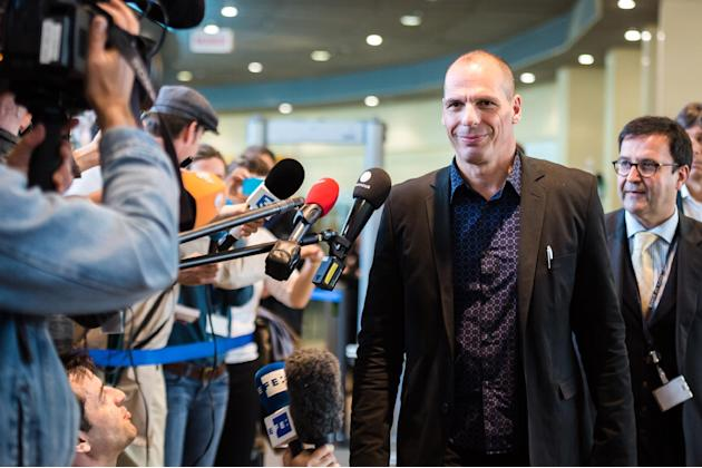 Greece's Finance Minister Yanis Varoufakis leaves after a meeting with EU Commissioner for Economic and Financial Affairs, Taxation and Customs Pierre Moscovici at the European Commission headquar