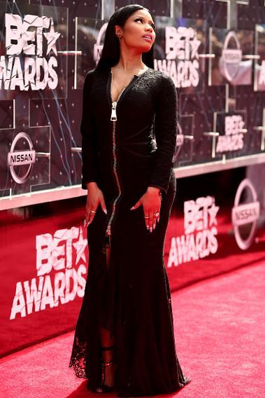 Nicki Minaj in a tight black gown.