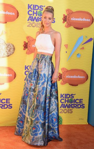 Iggy Azalea in a crop top and flared floral skirt