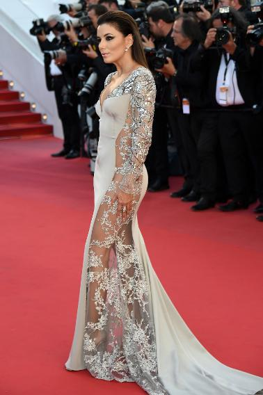Eva Longoria shows off the her gray gown's sheer panelling from the side.